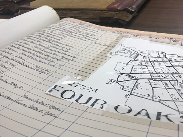 Open book showing Four Oaks Town Map